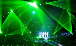 actress on stage. laser beams. concert
